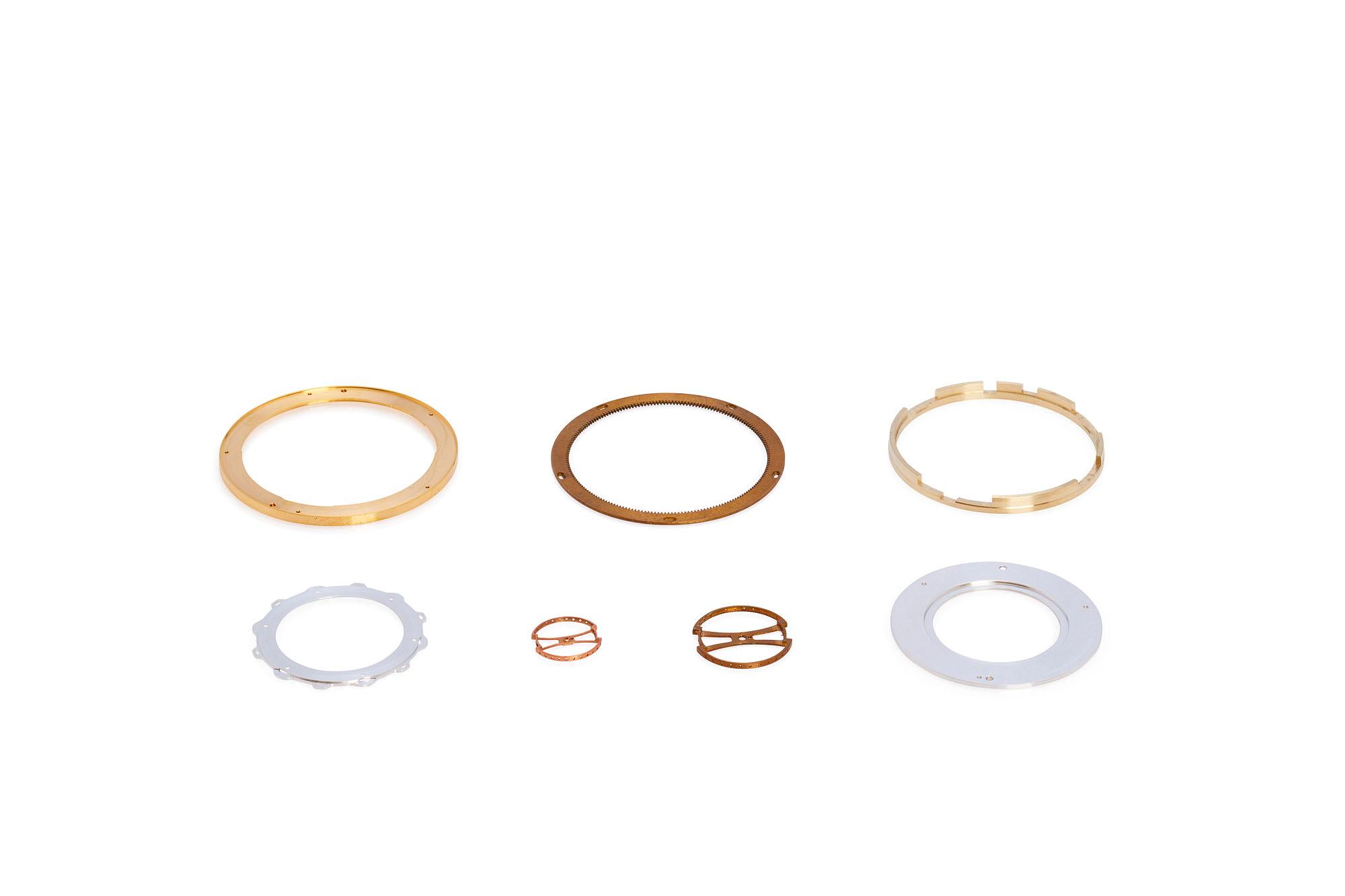 Abbildungen verschiedener Bestandteile der Uhrenindustrie